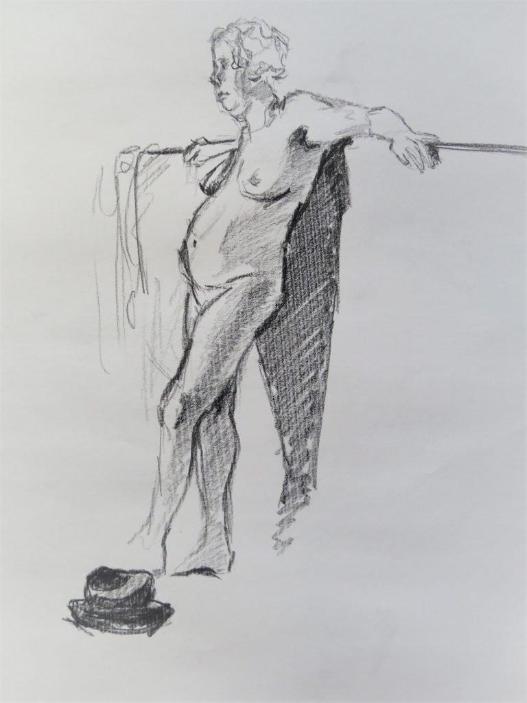schets houtskool vrouwelijk naakt met hoed op de grond