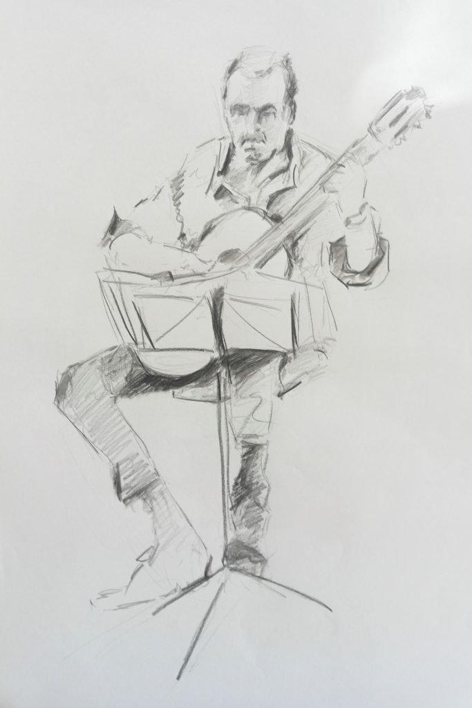 schets-muzikant-gitarist-met-lessenaar-potloodtekening