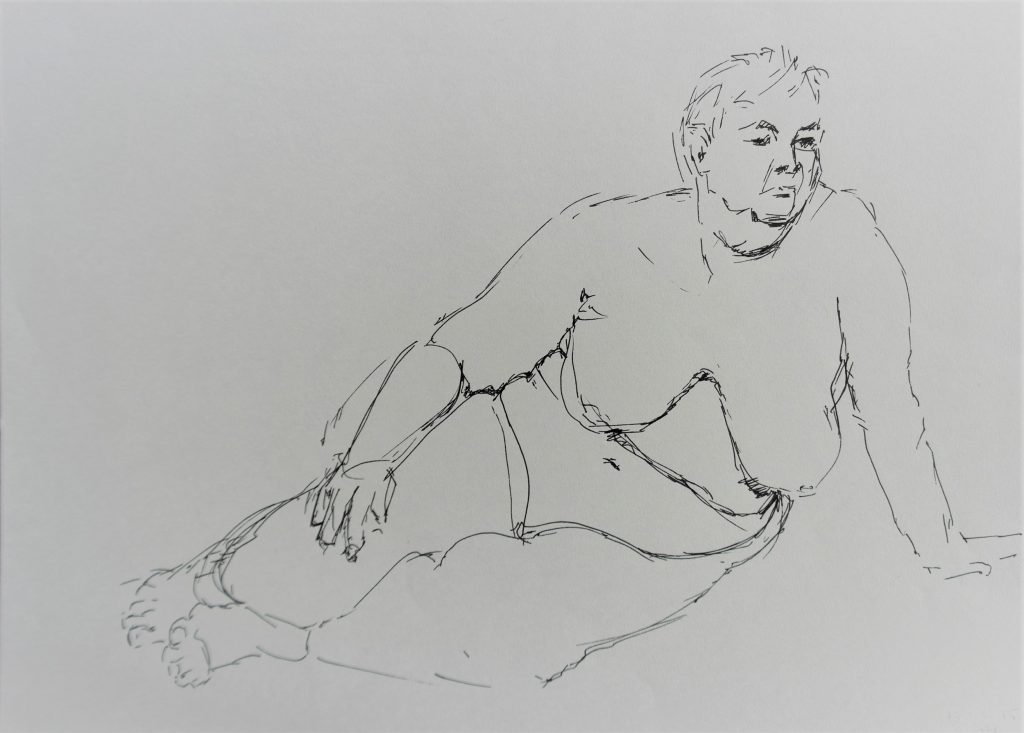 schets-vrouwelijk-naakt-leunend-op-een-hand-vulpen-zwarte-inkt